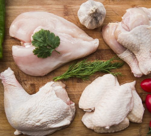 raw-chicken-and-ingredients-for-cooking-on-wooden-table-2
